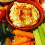bowl of hummus with vegetables